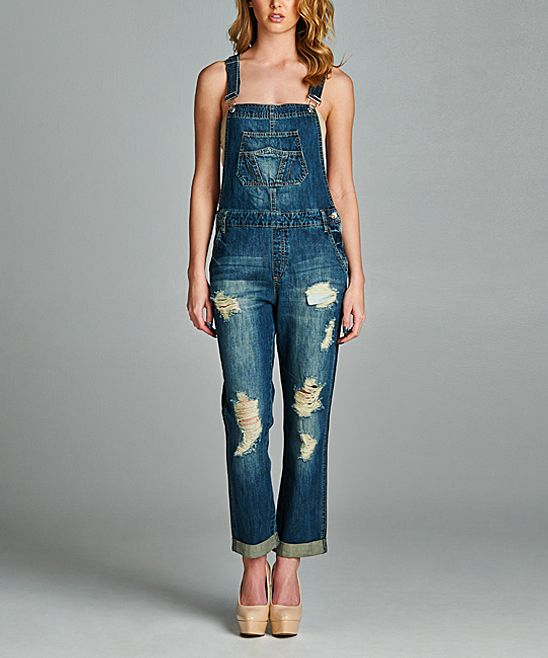 22cf115d92 Mix it up with this pair of laid-back denim overalls that feature trendy  distressed accents. Size S  28.5   inseam100% cottonMachine wash  hang  dryImported