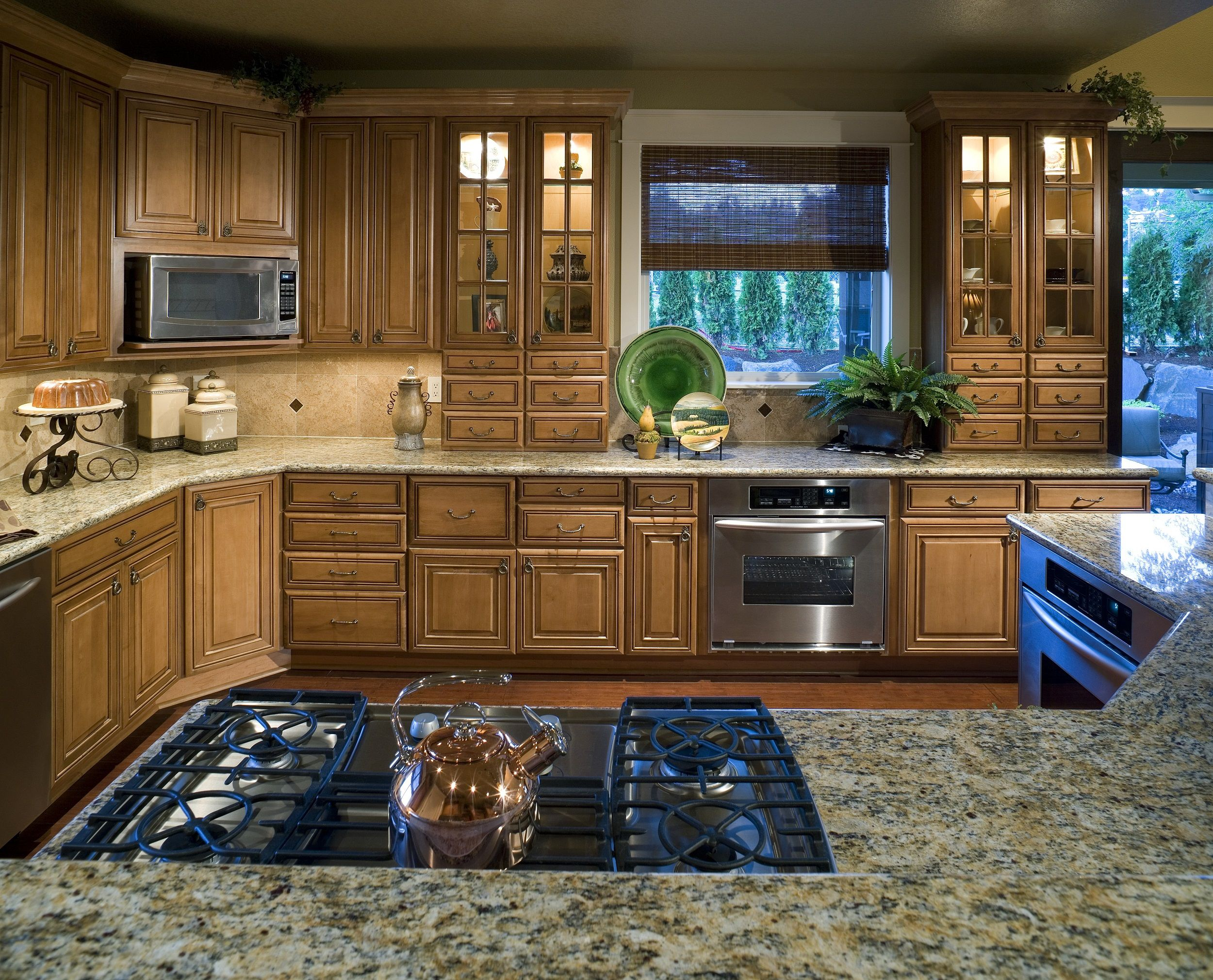 This charming kitchen is beautifully decorated with ...