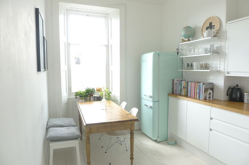 uncluttered, simple color scheme, wood counters, open shelving