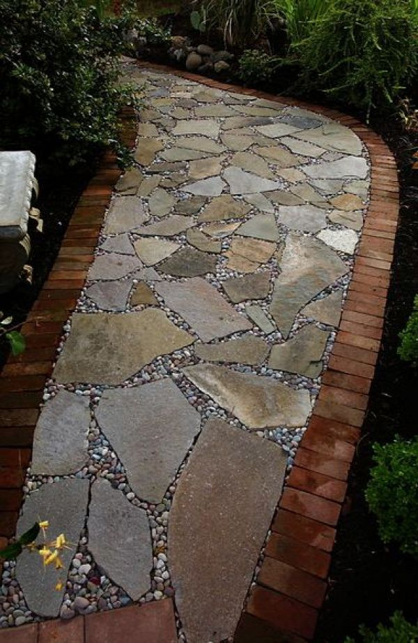 Flagstone path lined with brick and filled in with river for Laying river rock