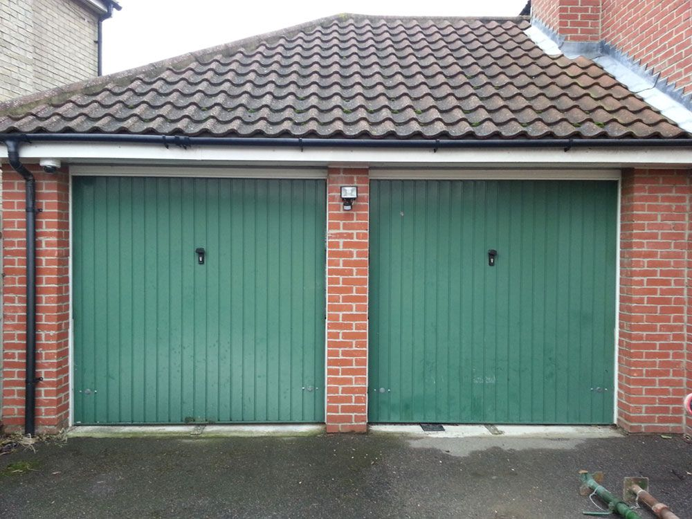 Garage Conversion Doors before - two single garage doors | double garage door conversion