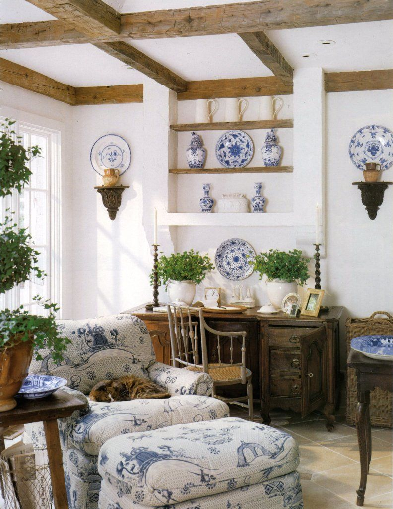 Pretty sitting spot in the living room. Love the blue and white ...
