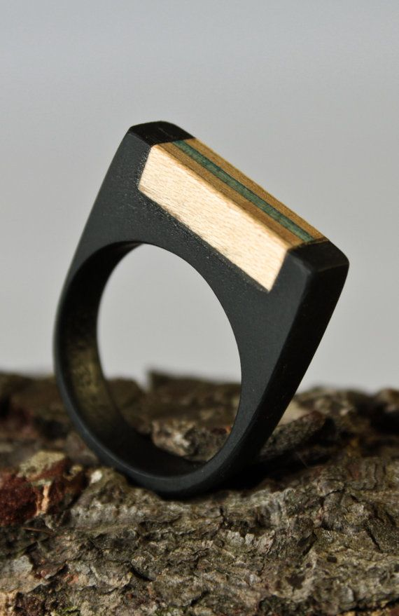 Ring, handmade in resin and recycled skateboard wood.