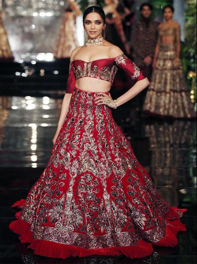 Deepika Padukone dazzled in a maroon lehenga with an off ...