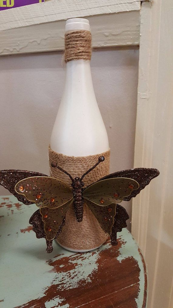 Check out this item in my Etsy shop https://www.etsy.com/listing/493355931/decorative-wine-bottle-butterfly-burlap