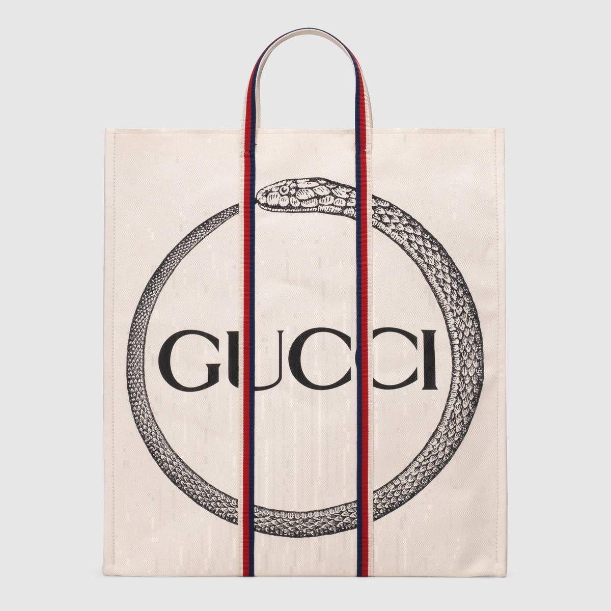 43081c2afa7 Shop the Gucci ouroboros print tote by Gucci. The canvas tote features an ouroboros  print