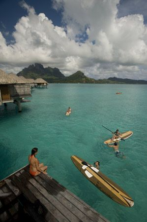 Stand-up paddle boarding at the Four Seasons Resort Bora Bora
