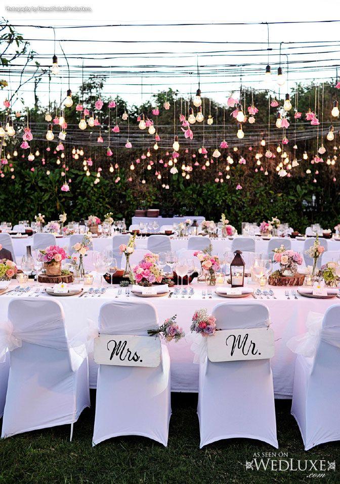 Wedluxe bali wedding with a beautiful hanging floral light wedluxe bali wedding with a beautiful hanging floral light display above the wedding table centerpieceswedding junglespirit Choice Image