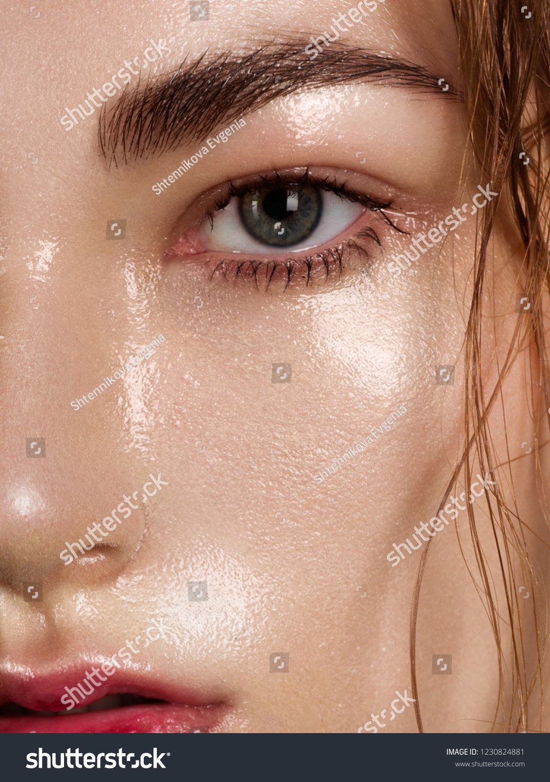 Close up beauty of a half face of a woman with wet radiant
