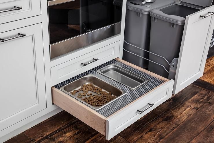 White Kitchen Cabinets Adorning Polished Nickel Pulls Are Fitted