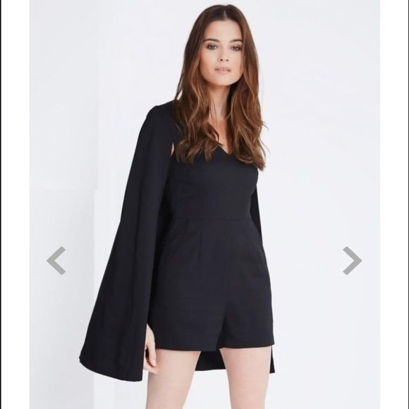 Lavish Alice Cape Playsuit or Romper Black cape playsuit. Perfect transition piece from spring to summer. Brand is Lavish Alice which is sold in Asos. Brand new with tags! Size UK 6. ASOS Dresses