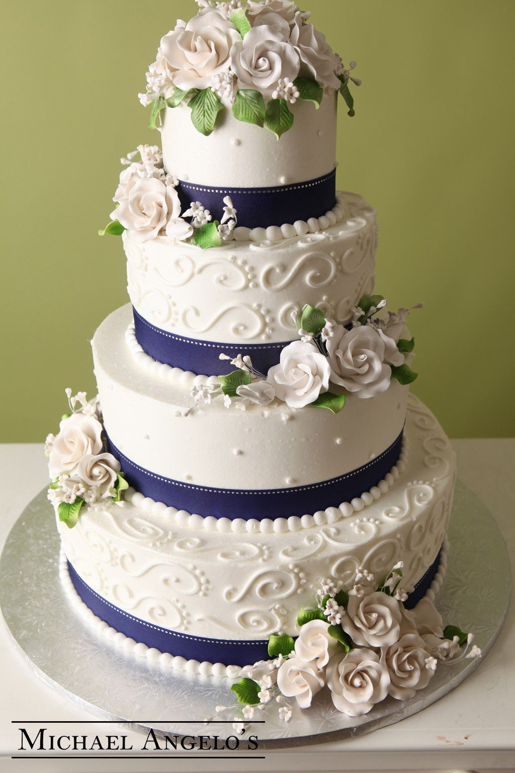 Simple Royal Roses 23Ribbons This Four Tier Buttercream Is Wrapped With A Blue Satin Ribbon White Stitching The Cake Simply Decorated