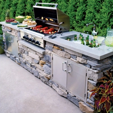 A Fieldstone Outdoor Kitchen Is Topped With Gray Quartz