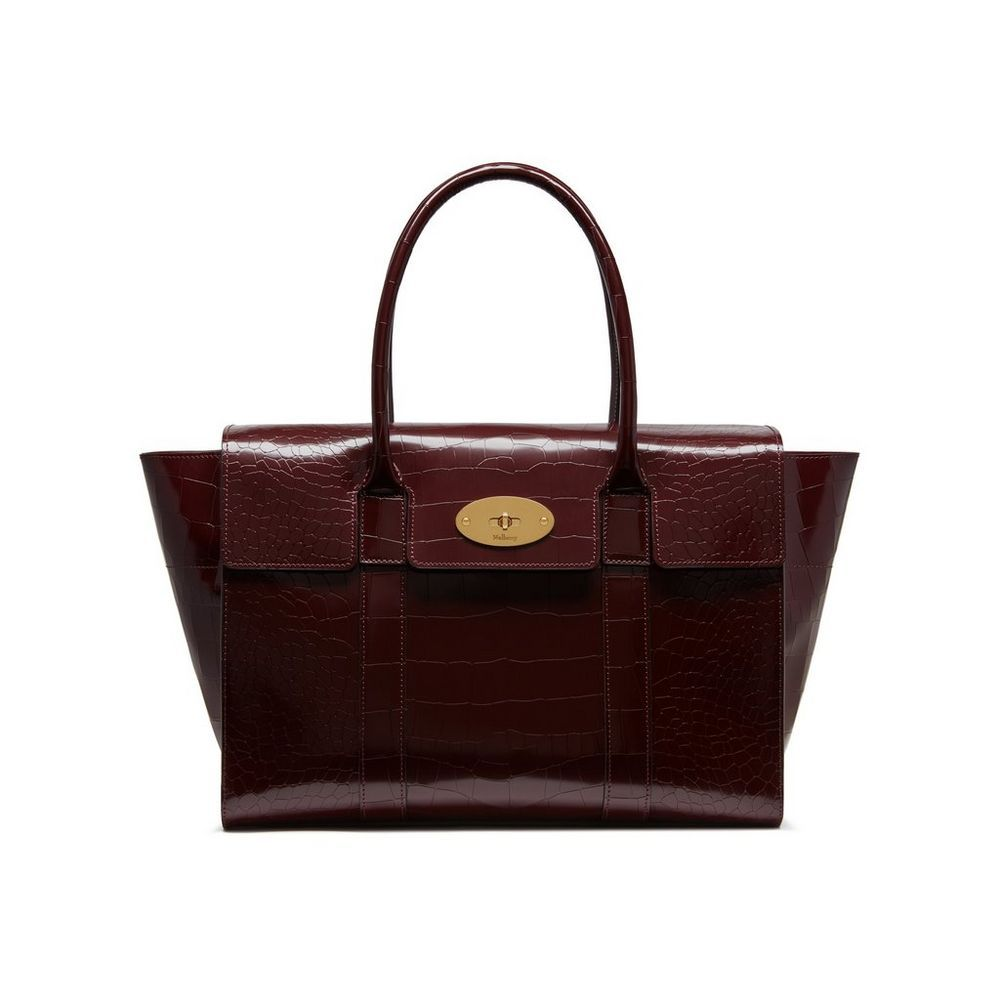 Shop the New Bayswater in Burgundy Polished Embossed Croc at Mulberry.com.  The Bayswater is Mulberry s most iconic leather bag. Launched in 2003, its  simple ... 5b3e86e414