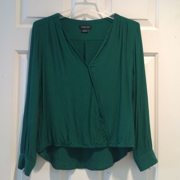 Cross front blouse Emerald green rayon blouse with a silver zipper detail on both sleeves. V-neck with a cross front look. From Nordstrom. Looks cute with blue or white jeans. Only tried on after the price tag was cut off, but didn't fit me :( Trouve Tops Blouses