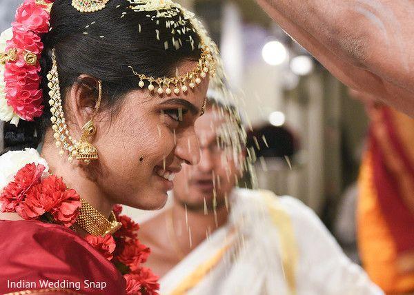 Indian groom showering rice to bride http://www.maharaniweddings.com/gallery/photo/115075