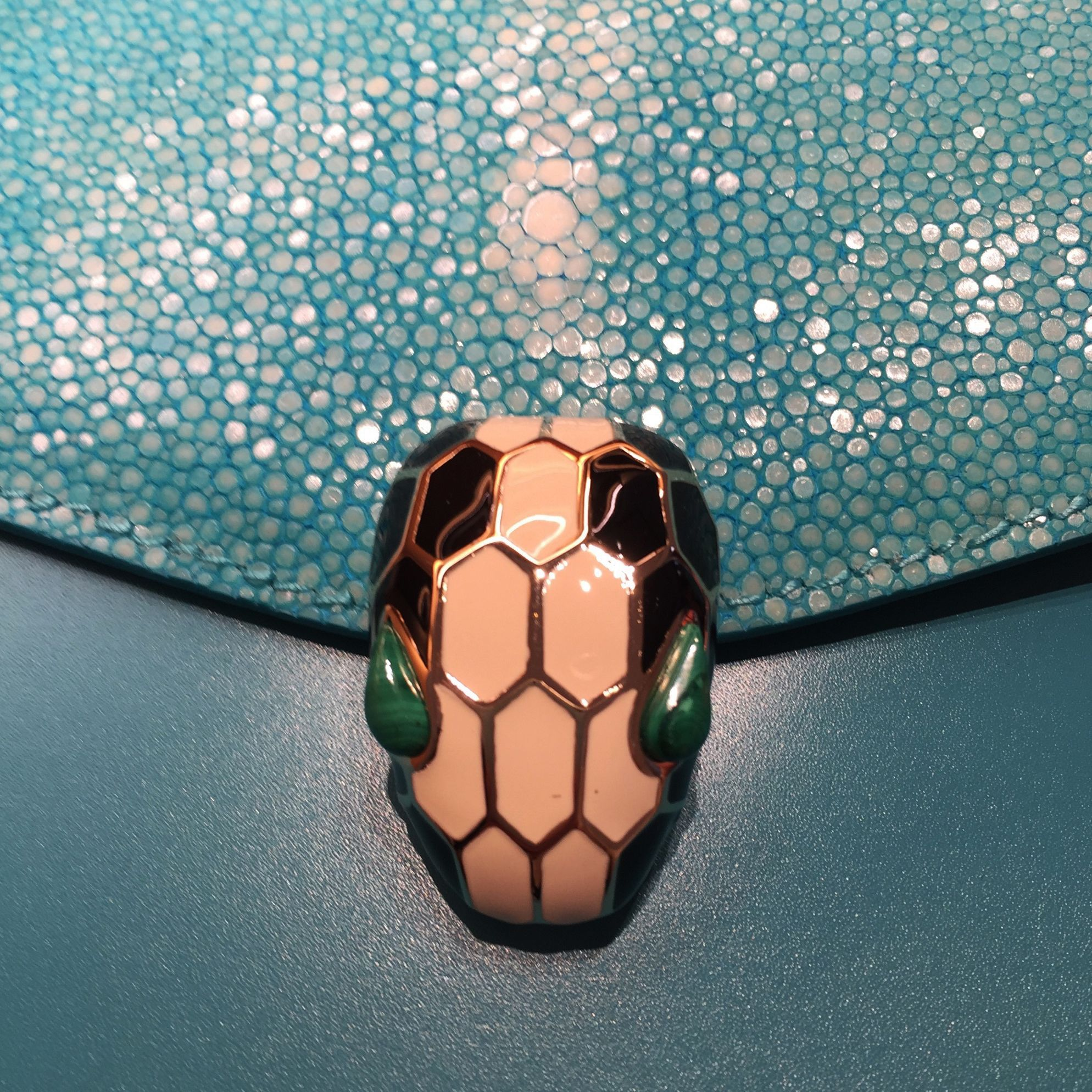 Bulgari Serpenti handbag with enamel  serpent clasp detail on blue galuchat skin.