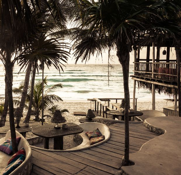 A Collection Of Thatched Palapa Huts Spread Across Serene And Secluded Stretch Tulumâ S Beach Papaya Playa Hotel Is The Check In Chill Out Idyll