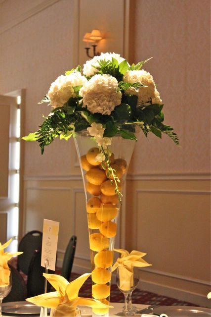 Tall arrangements filled with lemons and beautiful fresh hydrangeas make a great centerpiece!