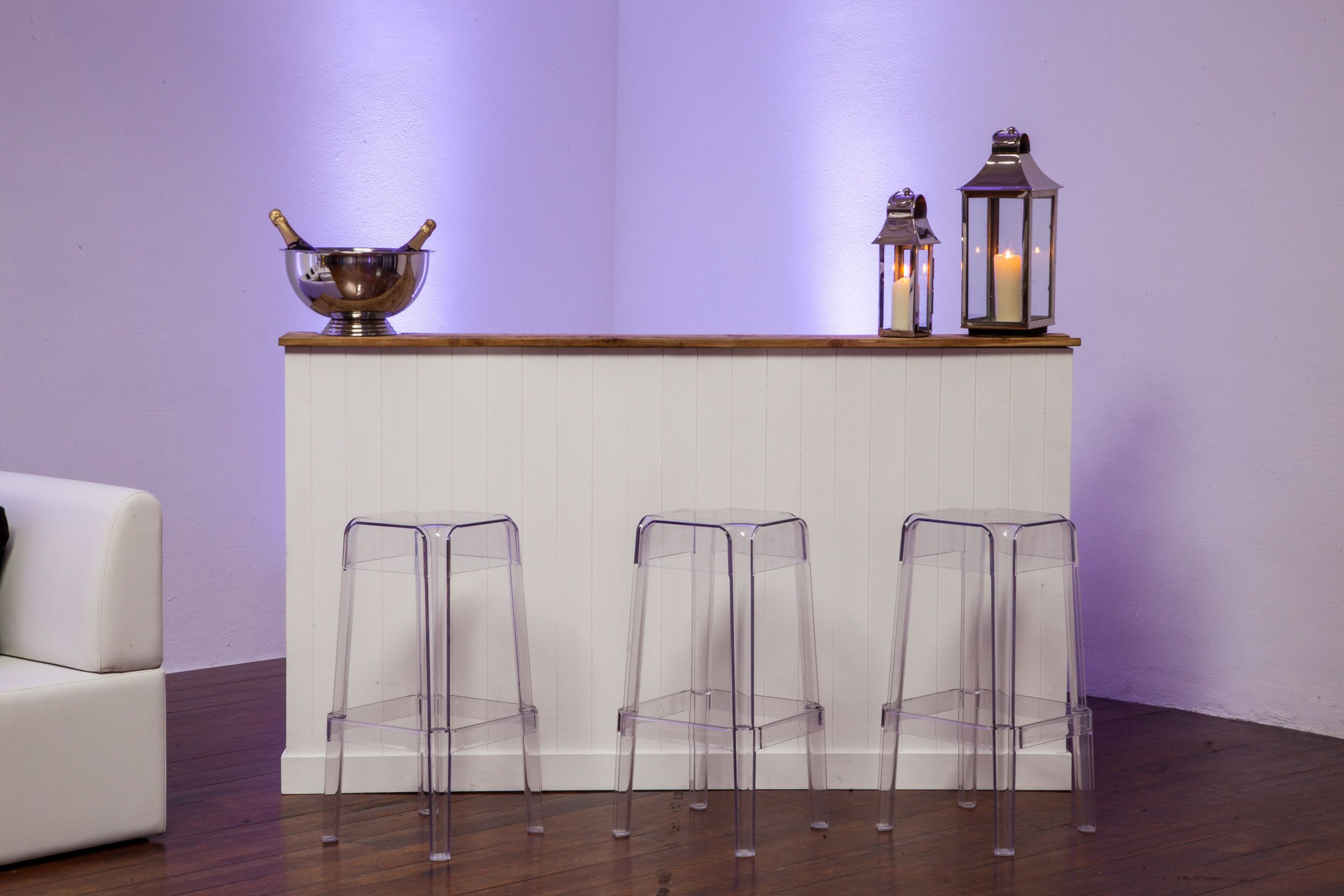 White tongue and groove rustic bar, clear Perspex stools, Champagne bowl, small and medium storm lanterns  #rusticfurniture #vintage #wedding #stormlanterns #interiordesign #warehousedesign #shoreditch #rusticwedding #outdoorfurniture #gardenparty #furniturehire