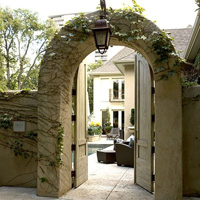 Classic courtyards foyers front doors and doors for Homes with front courtyards