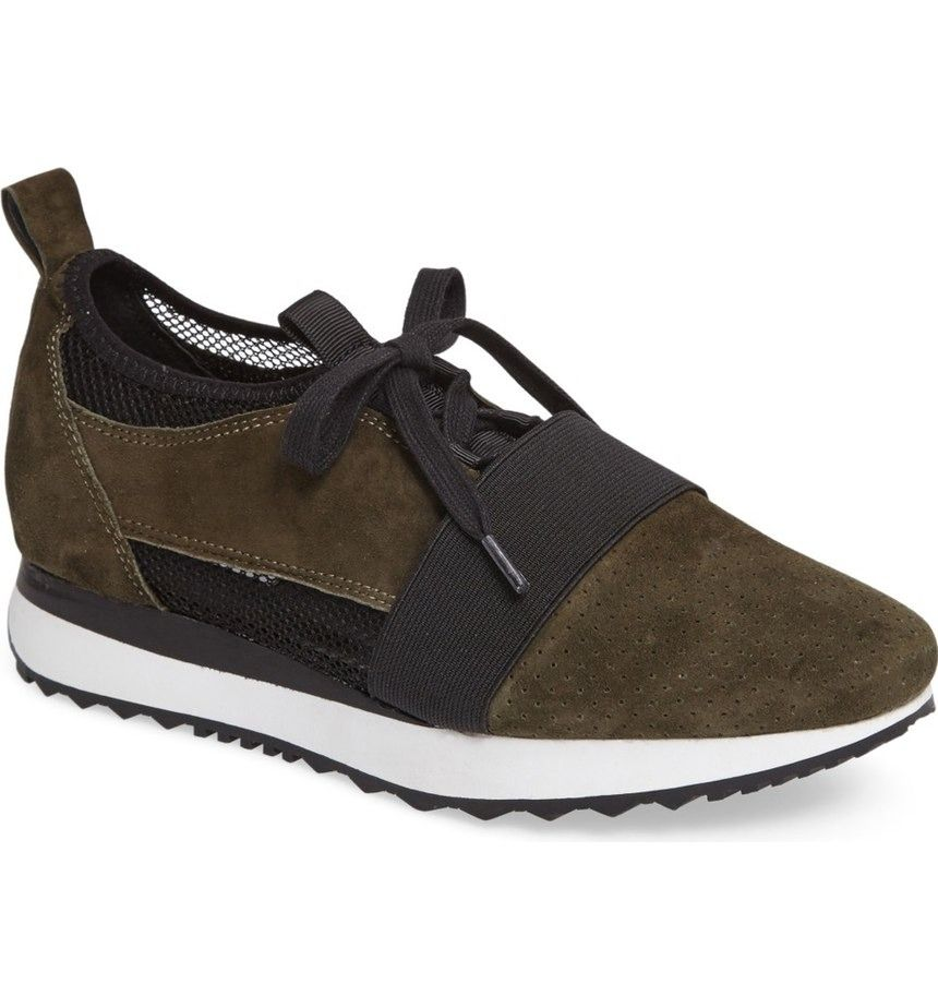 A bold elastic band, perforated suede, pieced leather and open-weave mesh give sporty, forward-thinking appeal to a breathable sock-fit sneaker with decorative lace-up detailing and a layered shallow-lug sole.