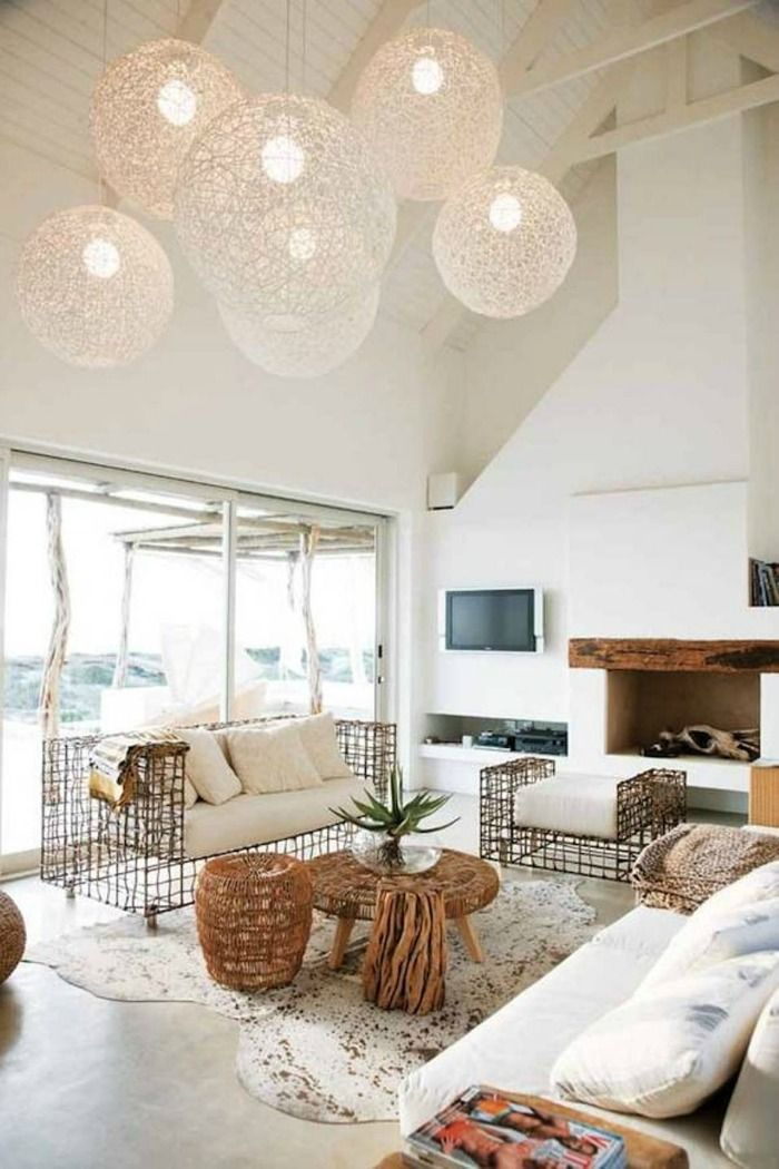 Beach House Design With High Ceiling And Globe Pendant Lightings And  Interesting Couch