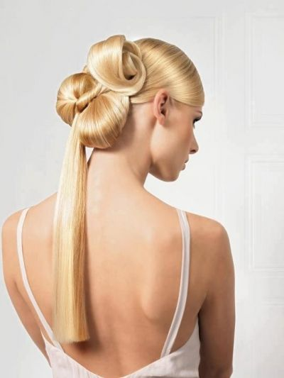 Avant-garde intricate bun hairstyle with long straight ponytail
