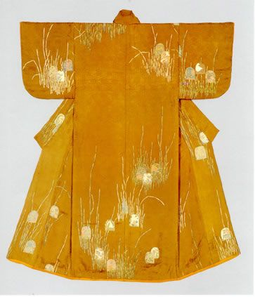 "Kosode with design of scouring rushes and the ""flowery rabbits"" motif Paste-resist dyeing (Yuzen) on brown figured silk satin (shusu), The last quarter of the eighteenth century (Mid-Edo period). This kosode has scouring rush and ""flowery rabbit"" patterns dyed in the Yuzen style, on a figured satin with woven designs of bamboo fencing and chrysanthemums. Although we do not see any rabbits, the birdcage-like object placed between the rushes symbolizes a rabbit."