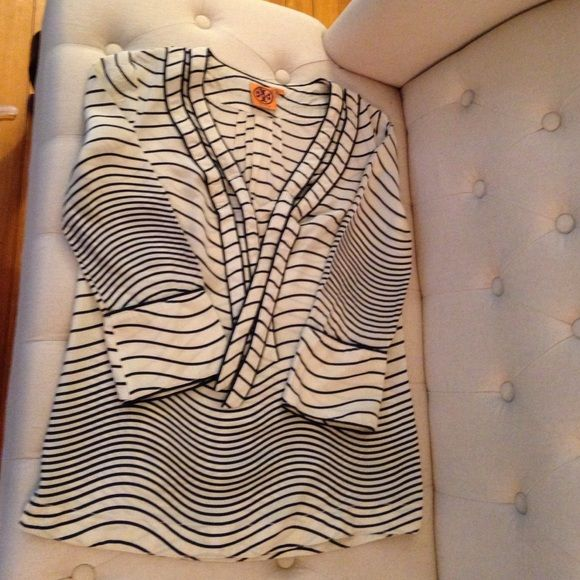 Tory burch silk stripe tunic 100% silk navy and cream stripe v-neck tunic with decorative tie detail. Slight color change under the arm.  Very subtle. Tory Burch Tops Blouses