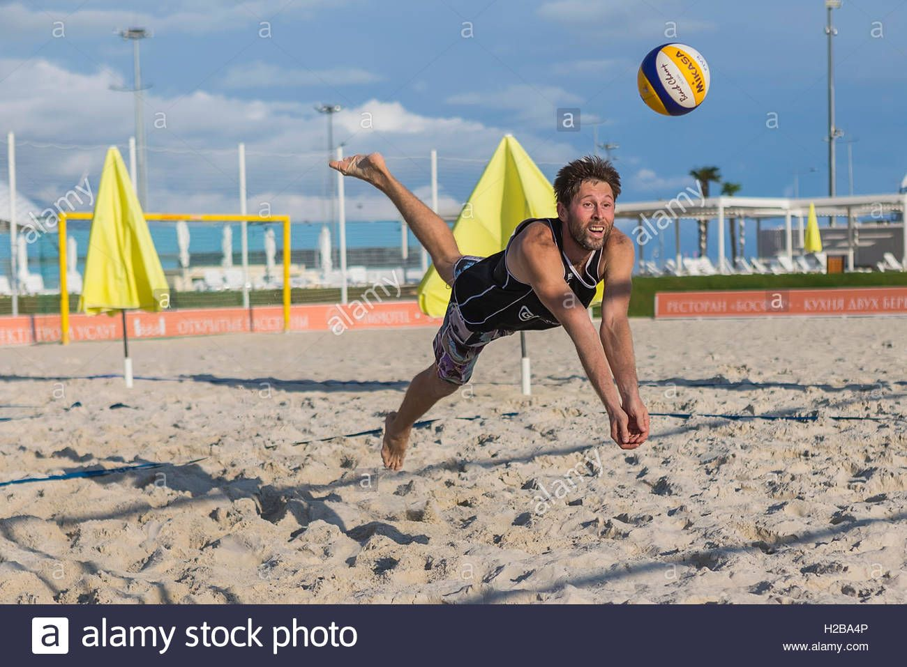Download This Stock Image Young Man In Motion Plays In Beach Volleyball H2ba4p From Alamy S Library Of Millions Of High Beach Volleyball Photo Stock Photos