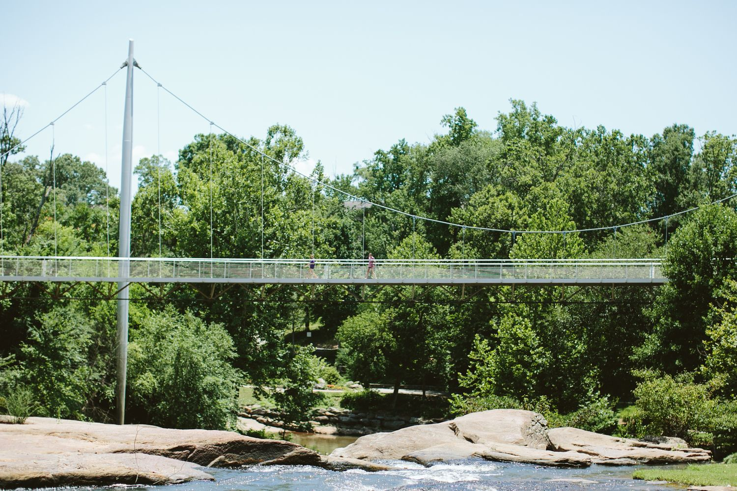 AshevilleFolk - Greenville, South Carolina City Guide: Falls Park. When visiting Greenville you must take a stroll through Falls Park and walk across the Liberty Bridge. Photo by Angela Cox.