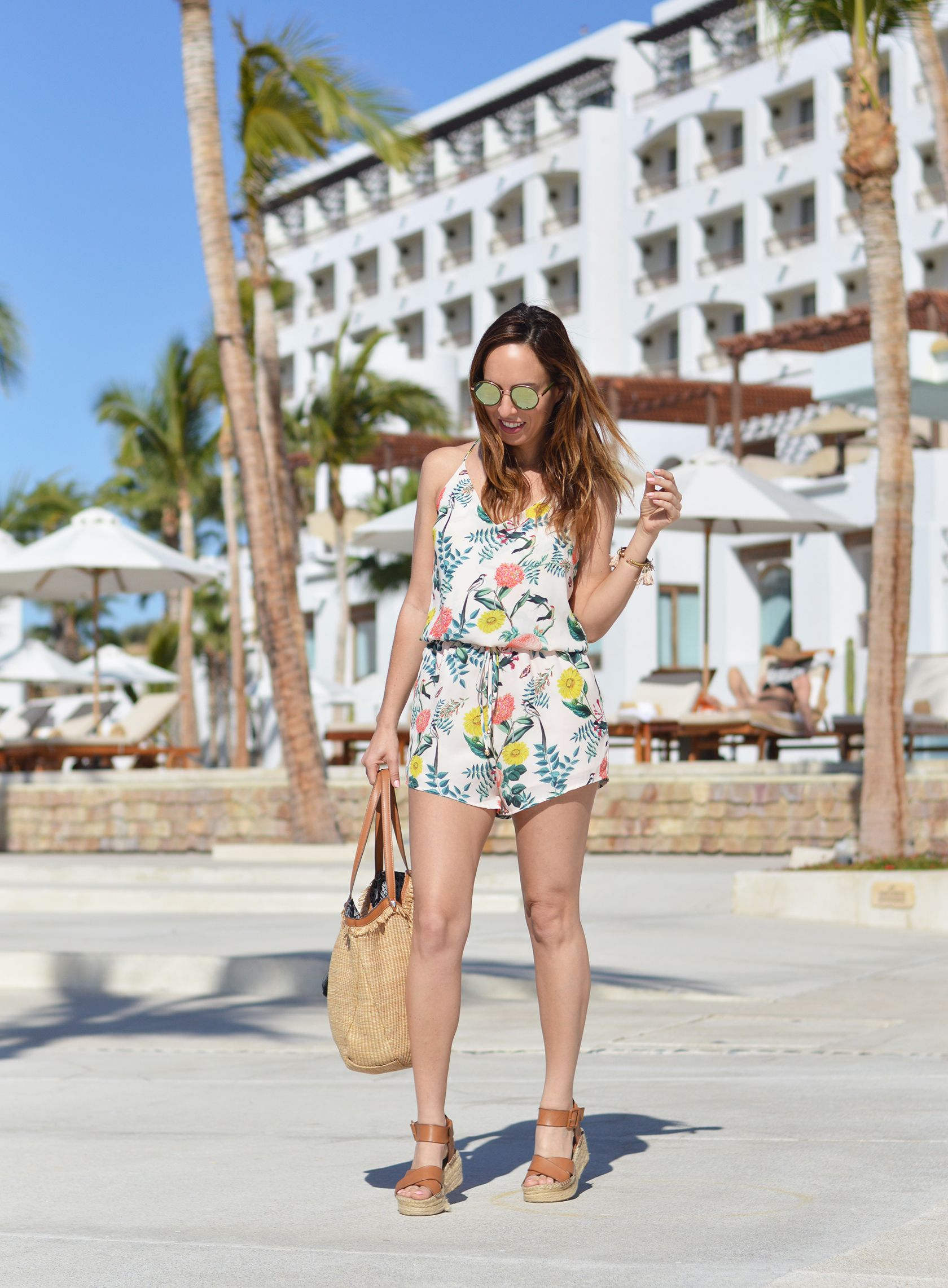 205e3326cd98 Sydne Style shows outfit ideas for a beach resort vacation in floral romper