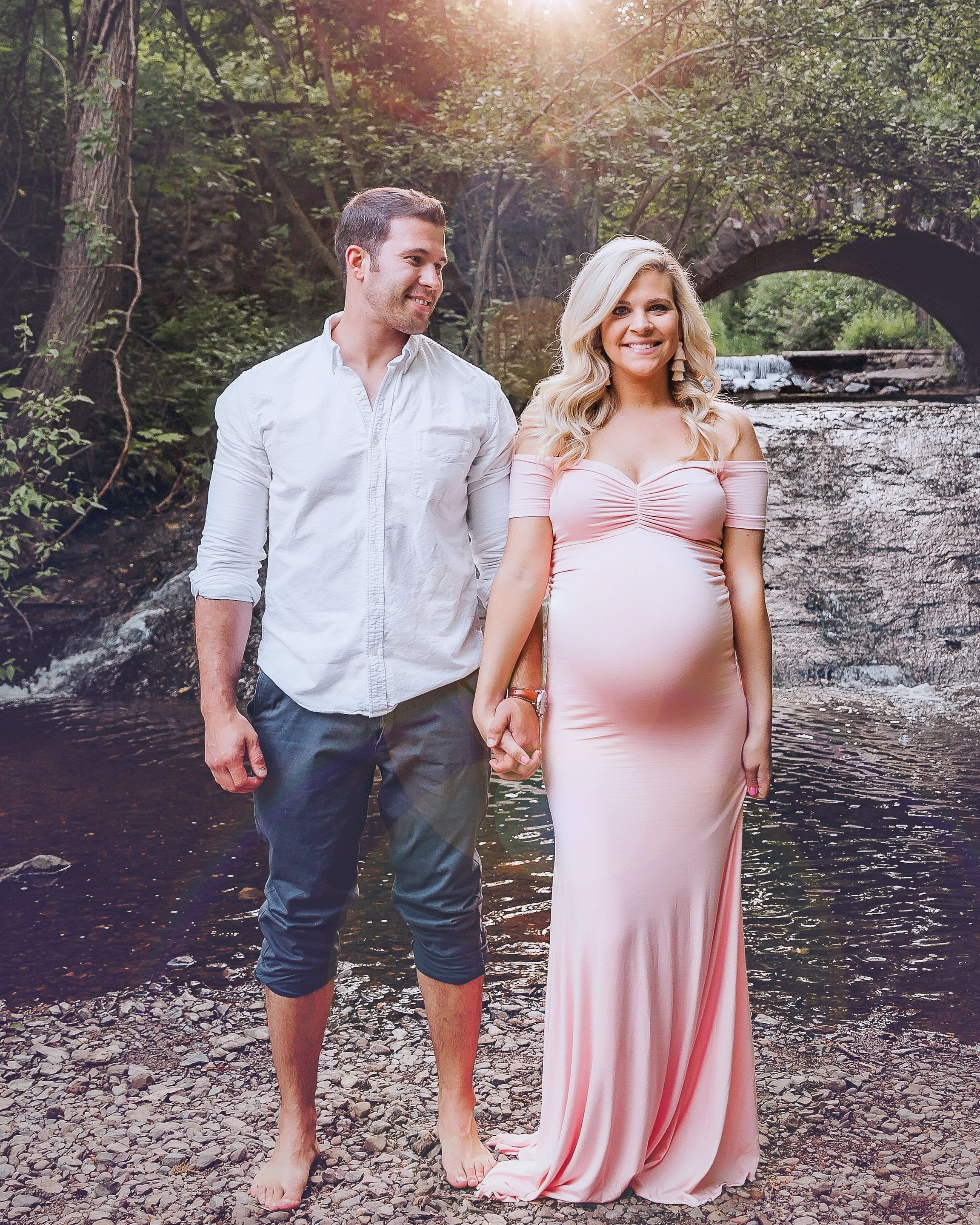 7b010ad3996 Cute couple maternity photos! This maternity gown is constructed with a  flared bottom that hits the ground