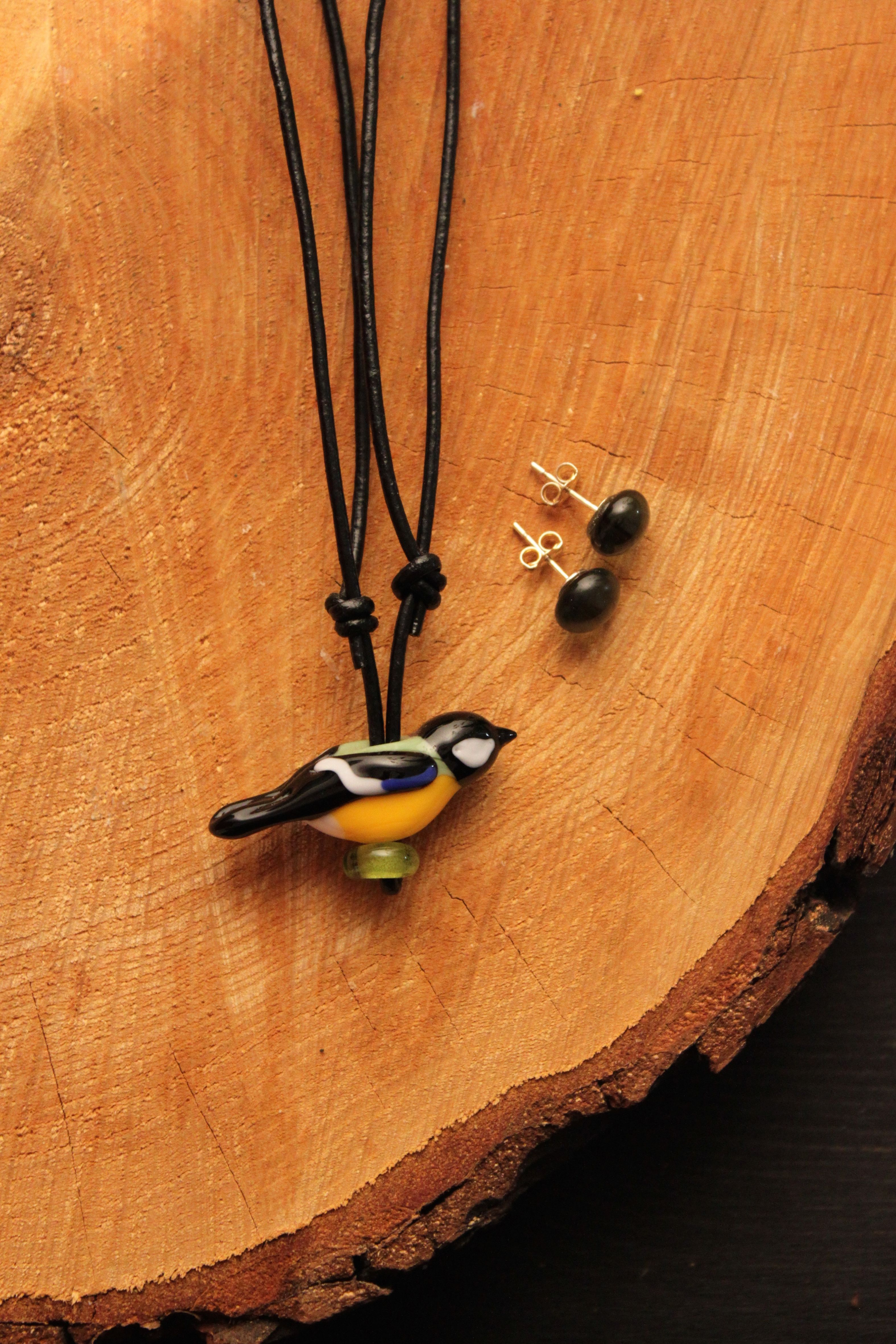 """The Great Tit is in Finnish called """"talitiainen"""". A small glass sculpture bird and earrings by Mafka / glass artist & glassblower Marja Hepo-aho."""