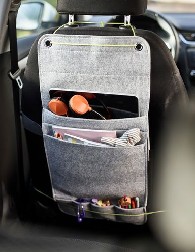 A Felt Hanging Organiser From Ikea Tied To The Back Of A Car Seat