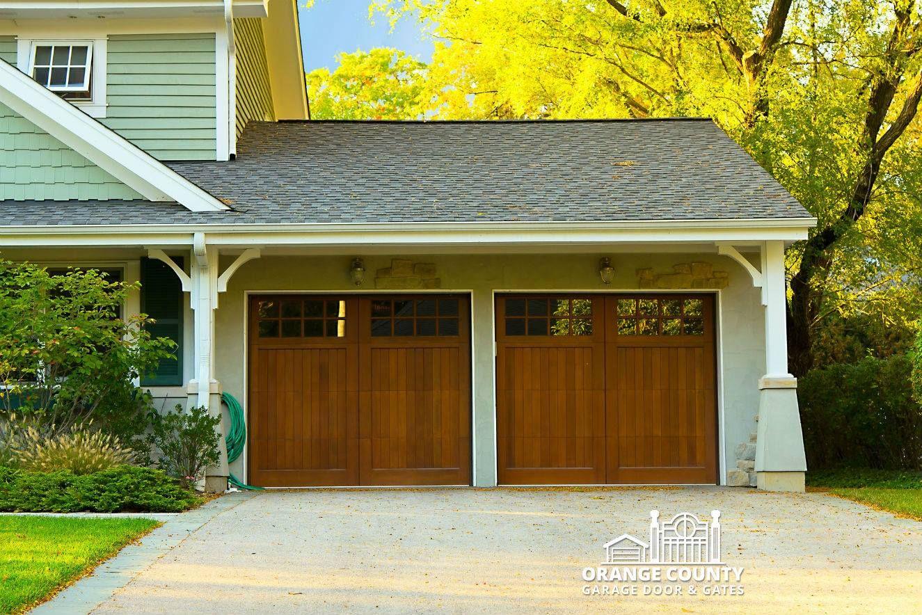 The Expert Garage Door Installation Wizards At Orange County Garage Doors Gates Can Seamlessly Inst Wooden Garage Doors Garage Doors Garage Door Installation