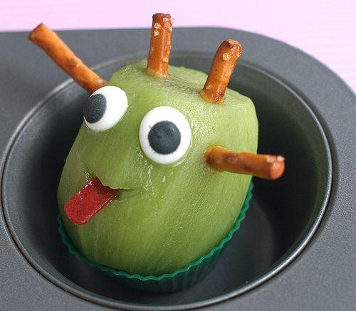 yummy (and healthy) monster craft!    peeled kiwi fruit, sugar icing eyes, pretzel sticks, fruit leather tongue