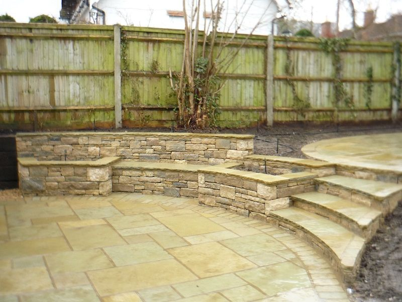 Indian split level patio with built in stone bench and planters ...