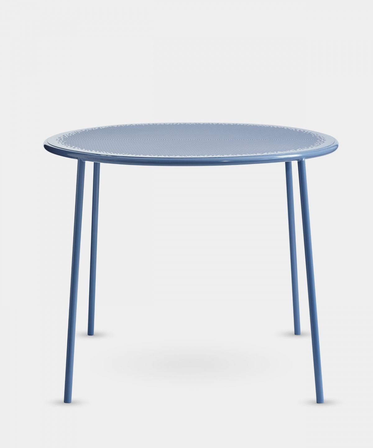 A minimalist metal table with a beautiful blue powder coated finish steel perforated top keeps the table feeling light airy dimma table by alexander