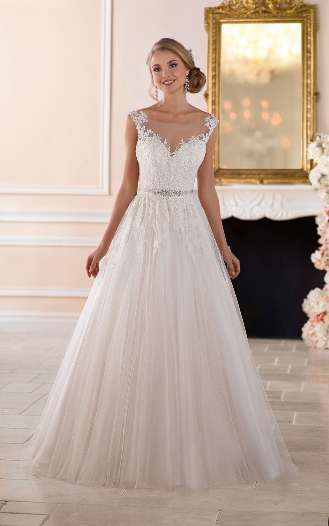 This romantic ball gown with keyhole back wedding dress by Stella York was made for fairytale moments! From the illusion lace and tulle neckline to the softly flowing train, every detail of this wedding dress evokes a sense of romance. The glittering belt is adorned with moonstone and Diamante beading for just a pop of shimmer. A sweet, illusion lace and tulle keyhole back finish this romantic wedding dress in the most elegant way. This stunning wedding dress is also available in plus sizes.
