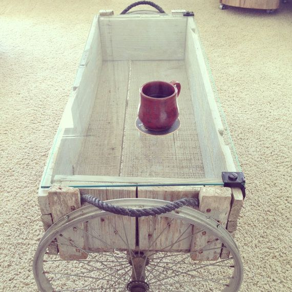 Hey, I found this really awesome Etsy listing at http://www.etsy.com/listing/156815410/glass-top-coffee-table-recycled-crate