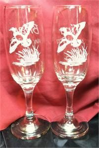 http://www.best-engraving.com/DuckHuntWedding.aspx  Duck hunt champagne flutes personalized