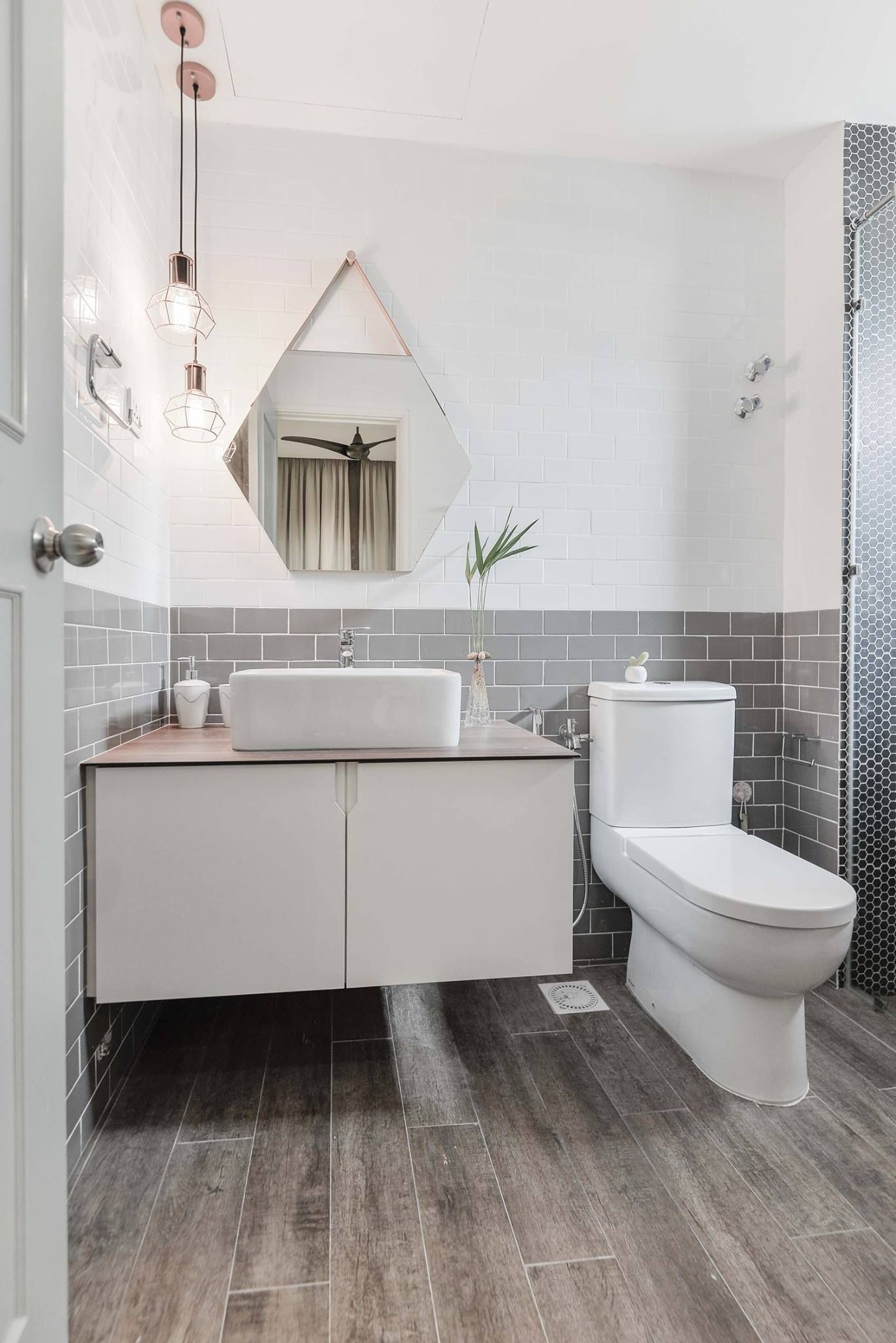 Two toned tiles on bathroom wall matches timber styled floor tiles ...