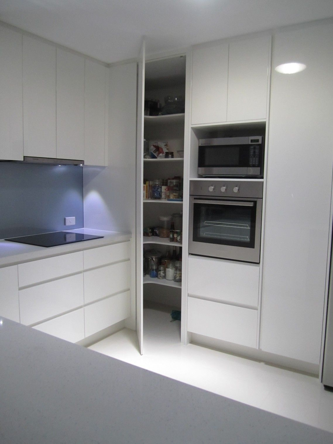 modern glossy solid wood floor to ceiling corner pantry in white finish combined with l shaped on small kaboodle kitchen ideas id=97607