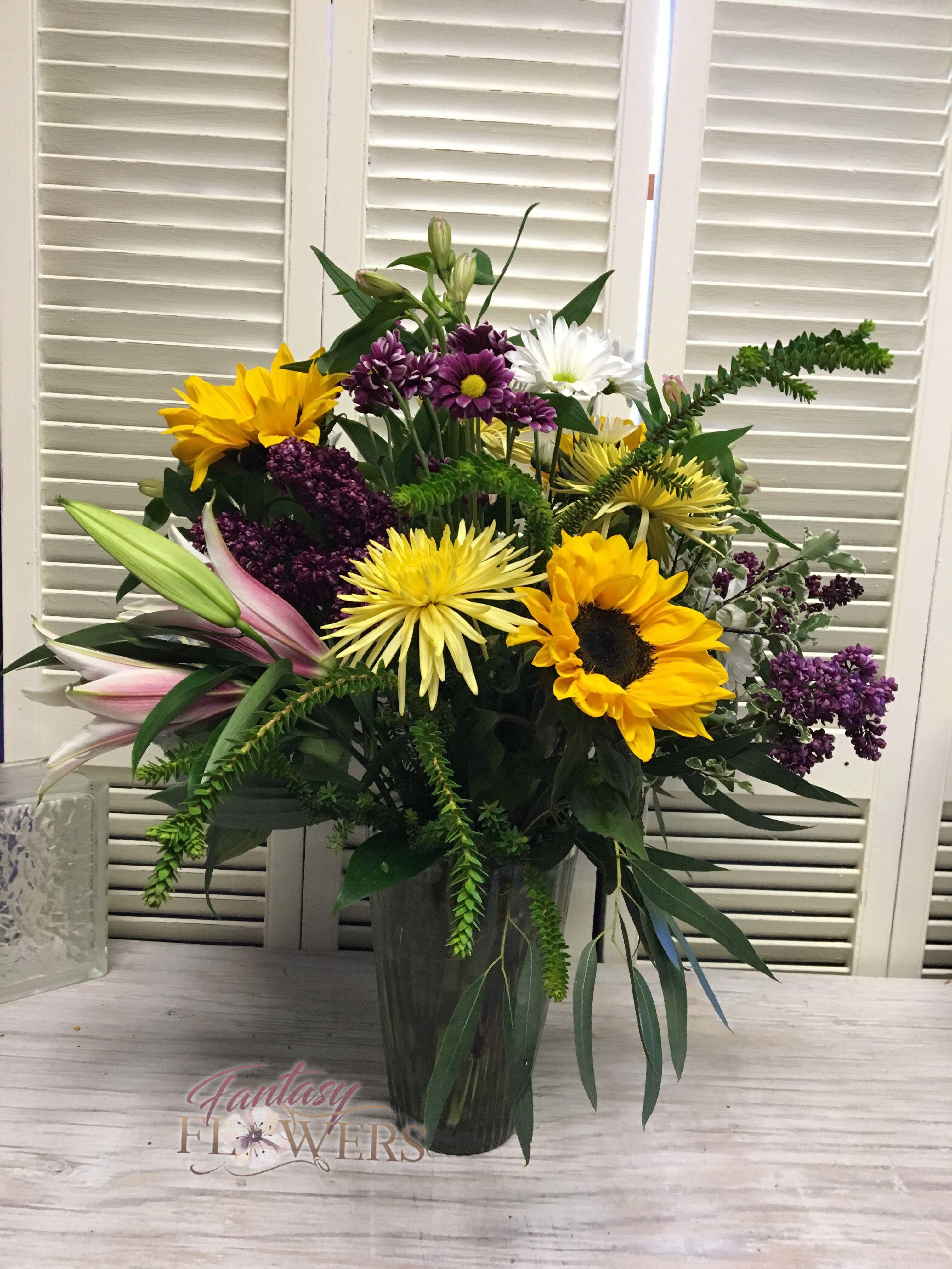 Sunflower madness. Vase filled with beautiful seasonal