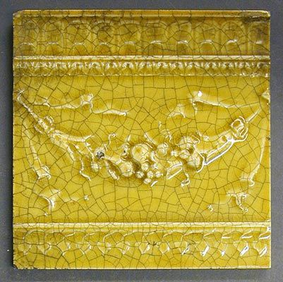 """Craven Dunnill and Co relief moulded dust pressed tile with a neo-classical design of fruit in swags with ribbons, olive glaze, 6"""" square, c1900"""