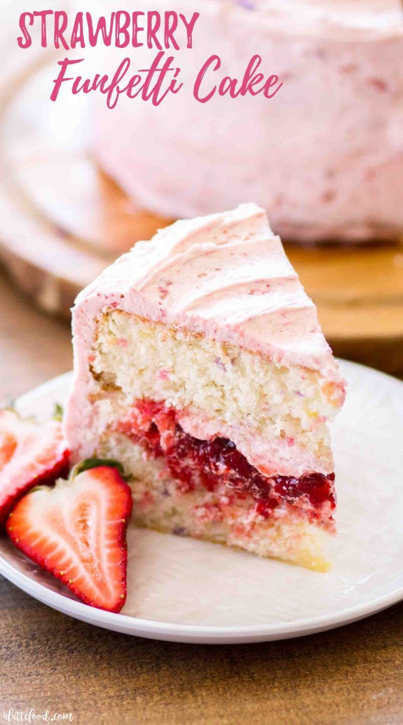 Slice of strawberry funfetti cake filled with fresh