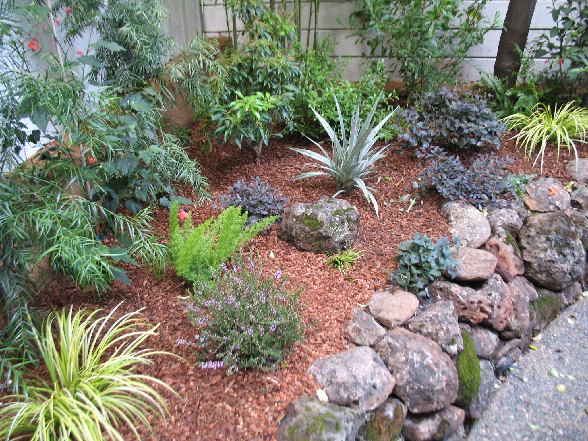 Moss Rock Walls Add Level Areas To Slopes Garden Landscape Design Landscape Design Garden Landscaping