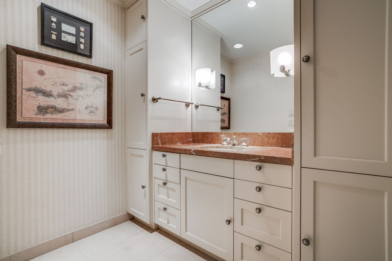 Salmon Colored Marble Countertop Contrasts An All White Bathroom